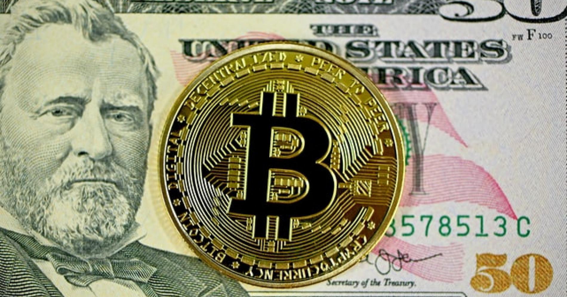 Bitcoin on a $50 bill (unsplash.com)